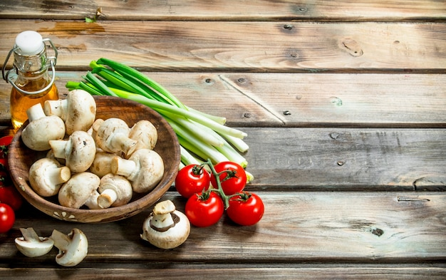 Healthy food. variety of organic vegetables and mushrooms  on rustic table.