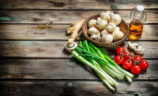 Healthy food. variety of organic vegetables and mushrooms  on wooden table.