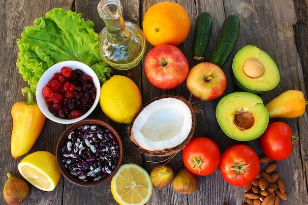 Healthy food of vegetable origin on old wooden background.