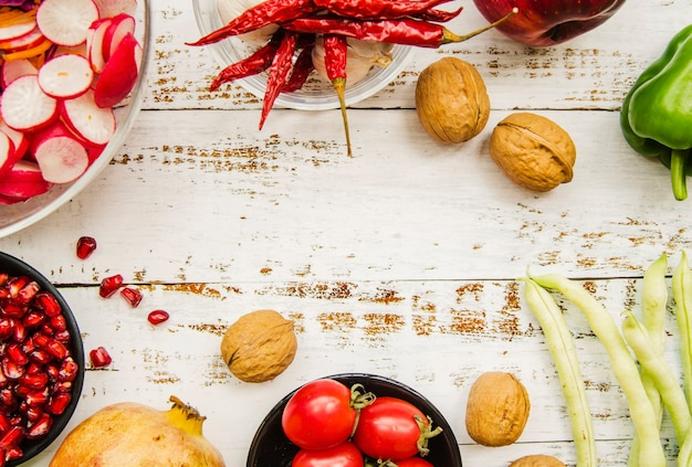 Healthy food on white weathered wooden table