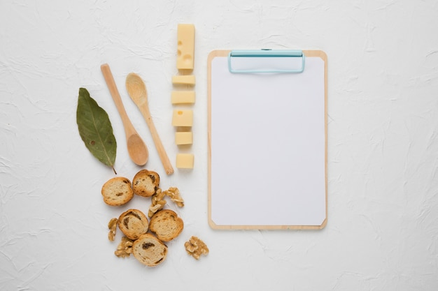 Healthy food with wooden blank clipboard on concrete backdrop
