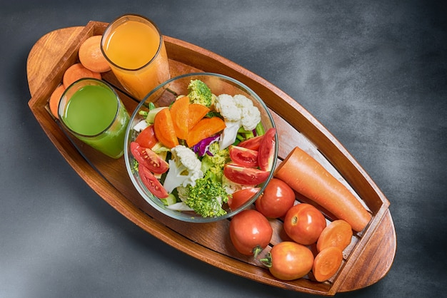Healthy foods are on the table, fresh vegetable salad in a glass bow