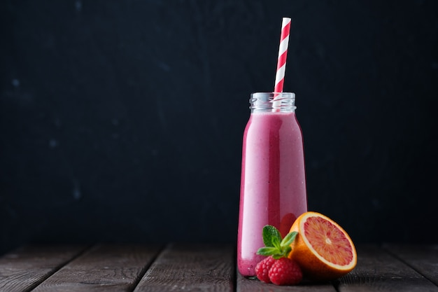 Healthy fresh fruit raspberry orange mint smoothie