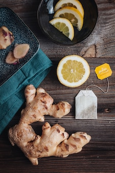 Healthy fresh raw ginger roots with lemon