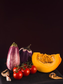 Healthy fresh vegetables on black background