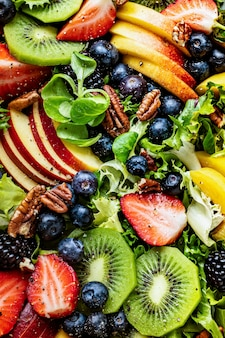 Healthy fruit salad with vegetables and pecans