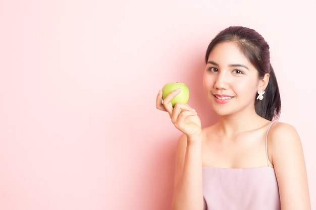 Healthy girl eating green apple