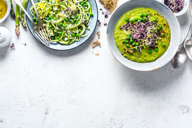 Healthy green pea soup and zucchini noodles