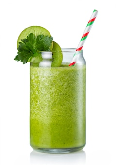 Healthy green smoothie in glass isolated