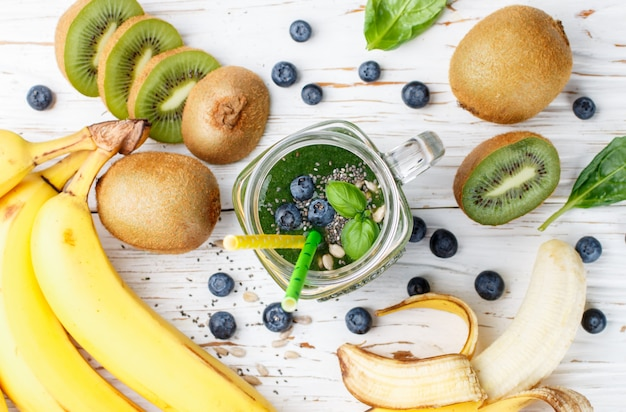 Healthy green smoothie and the ingredients