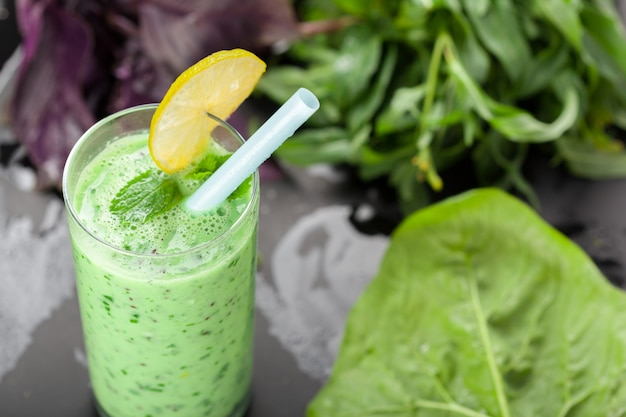Healthy green vegetable smoothie with apples,spinach,cucumber