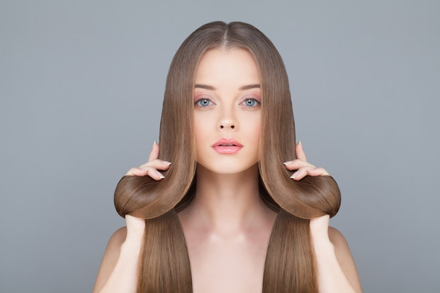Healthy hair woman on light blue background