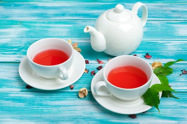 Healthy herbal tea over blue background
