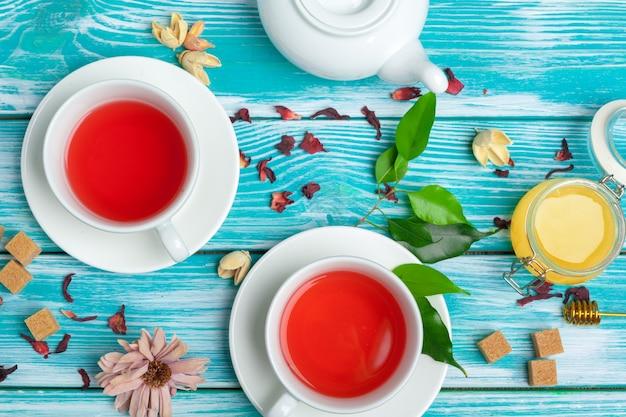 Healthy herbal tea over blue wood