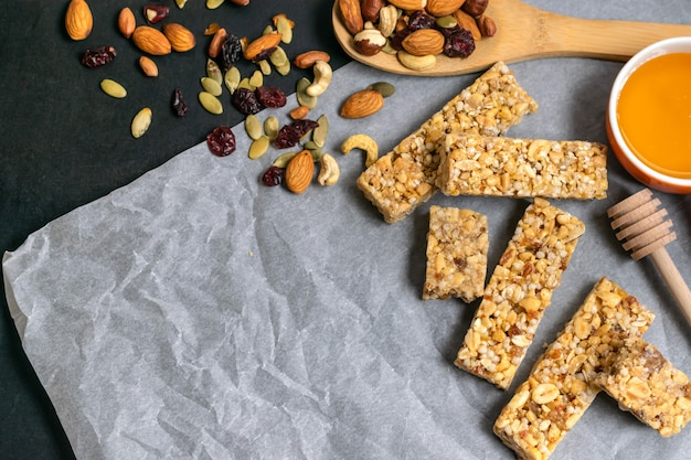 Healthy homemade granola cereal bars with nuts, dried fruits and honey