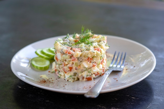 Healthy homemade russian traditional salad in plate