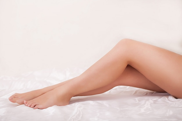 Healthy legs, spa, skincare, long woman legs and hands