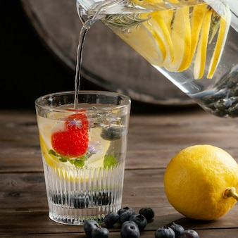 Healthy lemonade in glass arrangement
