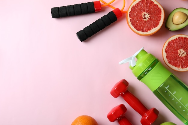 Healthy lifestyle accessories on pink background