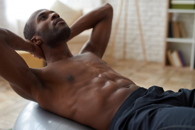 Healthy lifestyle for african american athlete at home.