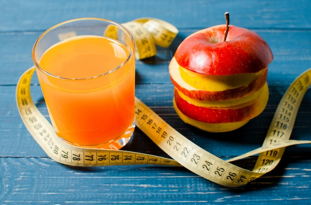 Healthy lifestyle. apple and orange juice on a wooden