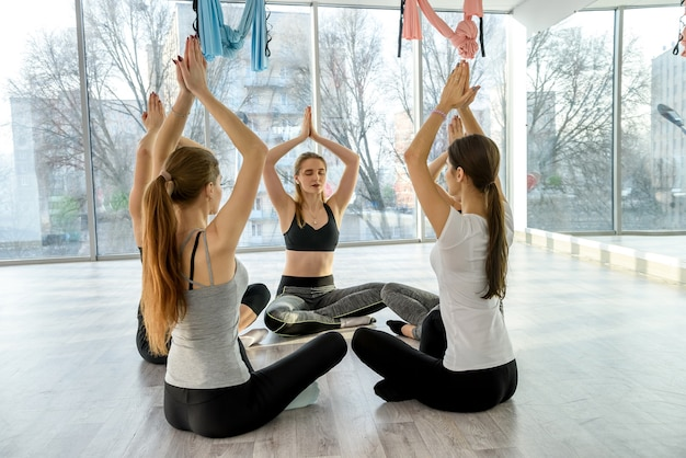 Healthy lifestyle concept. women in gym doing yoga