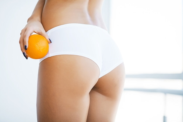 Healthy lifestyle and diet . closeup of beautiful slim woman body with sexy buttocks, big ass
