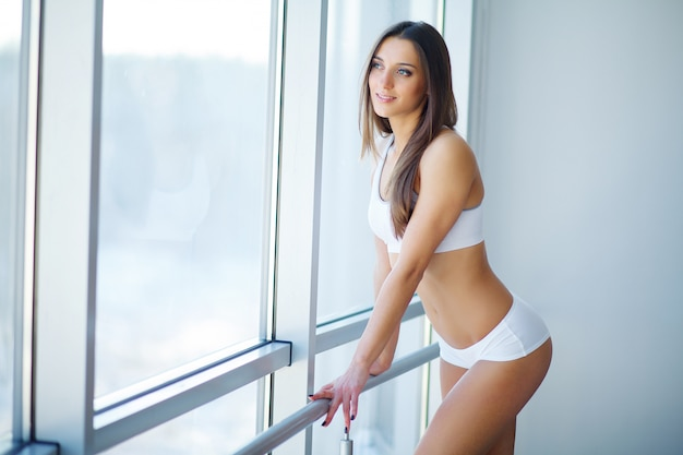 Healthy lifestyle and diet concept. smiling woman with beautiful body after diet