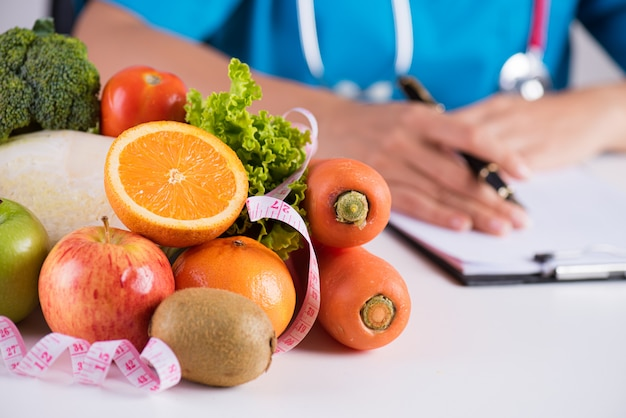 Healthy lifestyle, food and nutrition concept on doctor's desk.