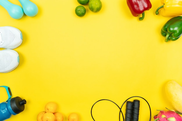 Healthy lifestyle, food and sport concept. athlete's equipment and fresh fruit and vegetable.