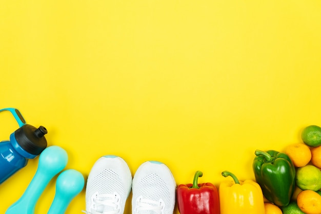 Healthy lifestyle, food and sport concept. athlete's equipment and fresh fruit and vegetable