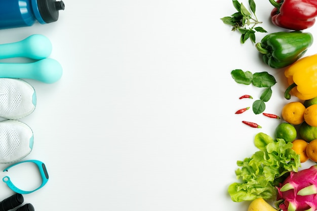Healthy lifestyle, food and sport concept. athlete's equipment and fresh fruit