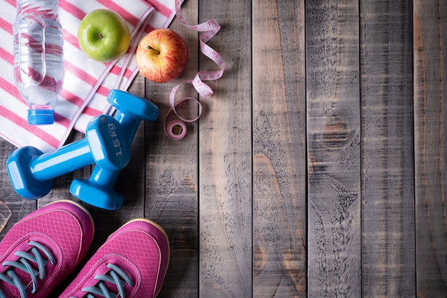 Healthy lifestyle, food and sport concept on dark wood