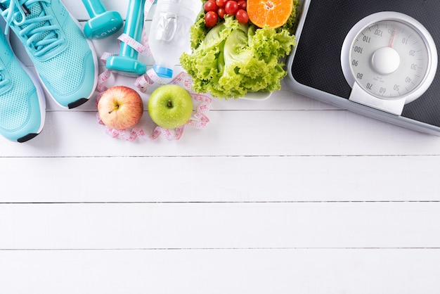 Healthy lifestyle, food and sport concept on white wood