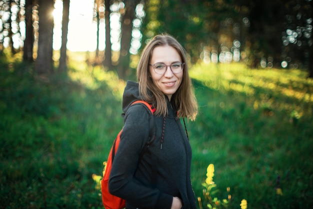 Healthy lifestyle woman walking in mountains in summer forest area