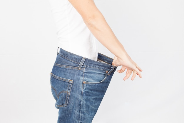 Healthy lifestyles  weight loss woman with old jeans healthcare, diet and fitness