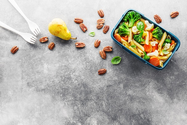 Healthy lunch to go served in box with vegetables
