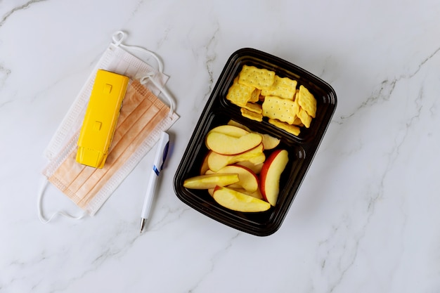 Healthy lunch and protective face masks