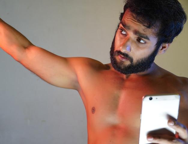 A healthy man taking selfie using his phone