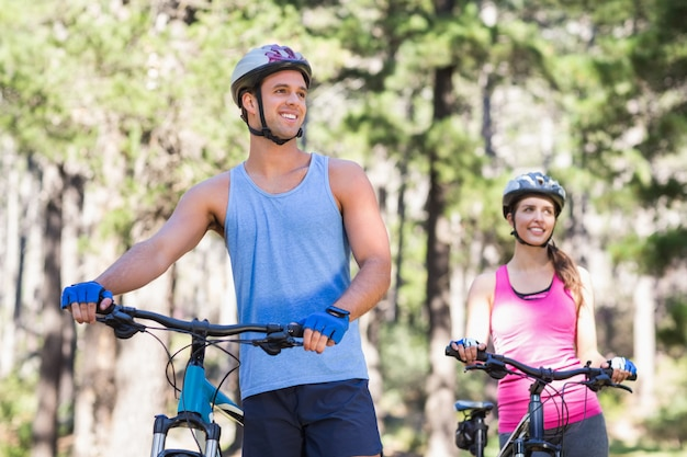 Healthy man and woman with bicycles