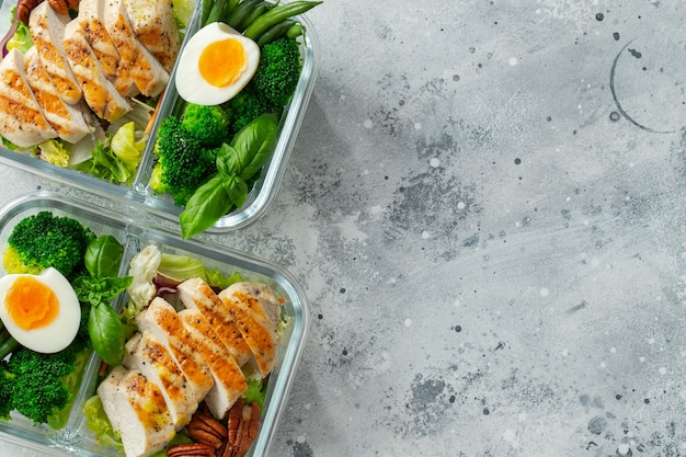 Healthy meal prep containers with chicken breast.