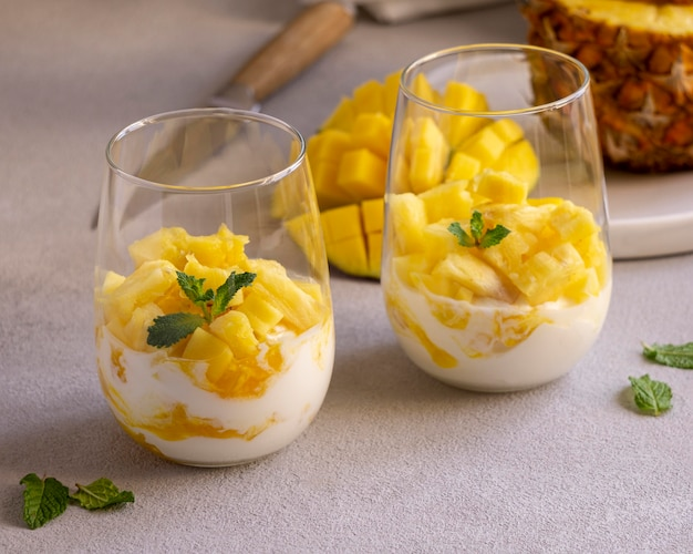 Healthy meal with yogurt and pineapple in glass