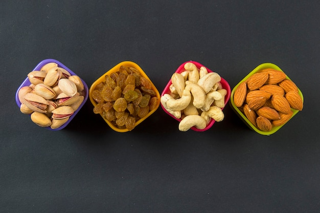 Healthy mix dry fruits and nuts on dark. almonds, pistachio, cashews, raisins