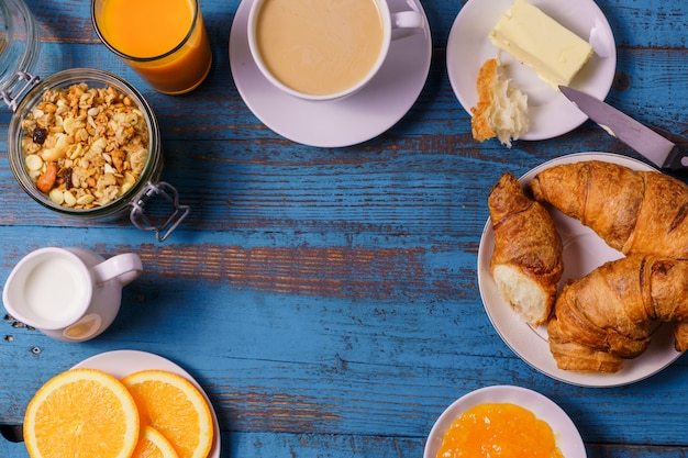 Healthy morning breakfast  served  with coffee,  juice,  orange, on old background, copy s
