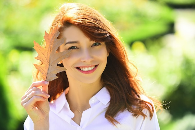 Healthy and natural woman beauty happy smiling girl with natural red hair autumn woman with bright o...
