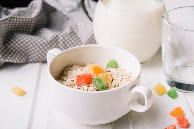 Healthy oat meal with jelly candies in the bowl