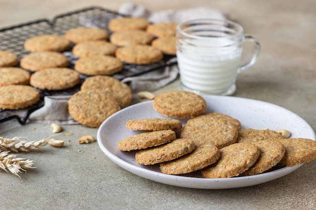 Healthy oatmeal cookies with cereals, seeds and nuts with a cup of milk