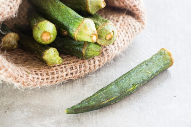 Healthy okra chips on clean background