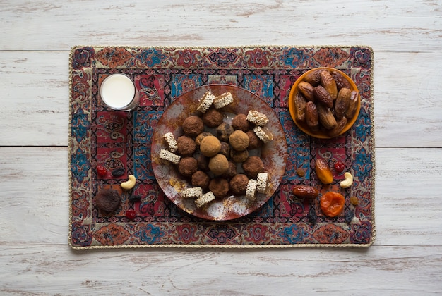 Healthy organic energy bites with nuts, cacao, dates and honey - vegan vegetarian raw snack or meal.