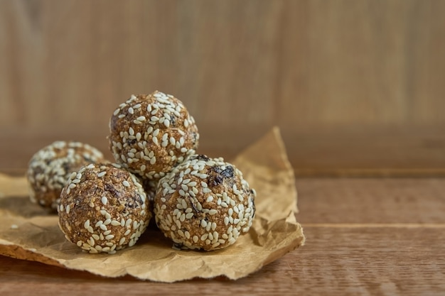 Healthy organic energy granola bites with nuts, cacao, sesame and honey. vegan and vegetarian raw snack